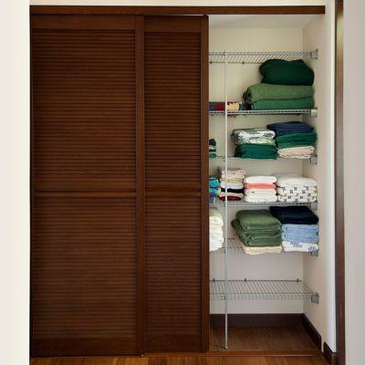 Puerta pvc nogal 50 cm x 200 cm veneciana puertas de for Catalogo de closets